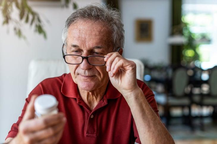 Man reading a prescription drug label