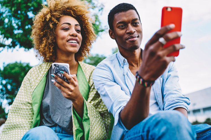 Couple looking at their smartphones