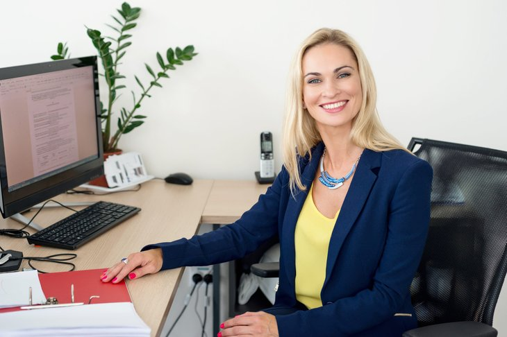 A businesswoman working at her desk