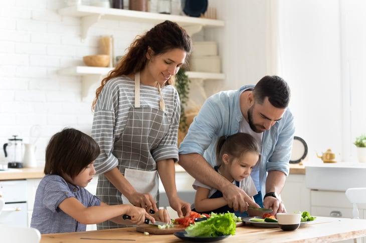 Family chopping vegetables