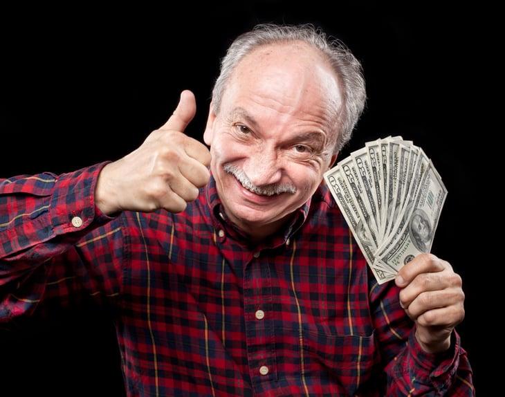 Senior man with money