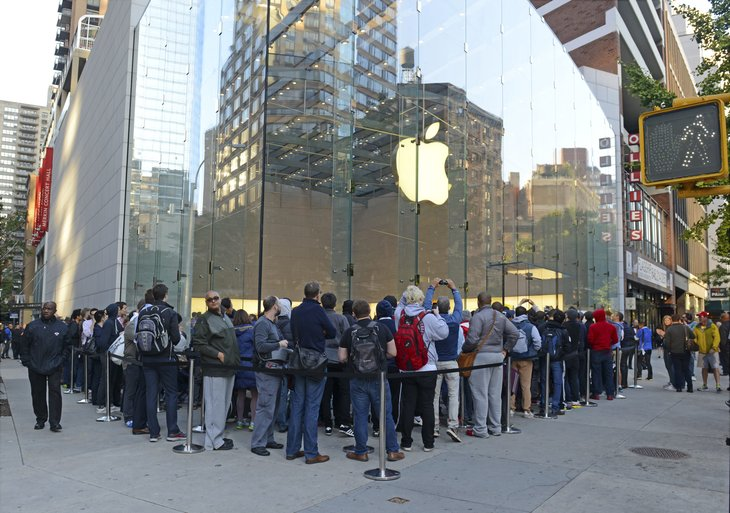 People waiting in line for an iPhone