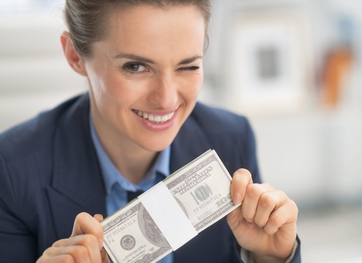 Winking woman with money