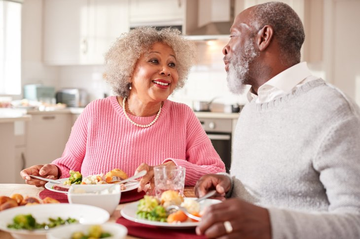 Senior couple eating a meal at home