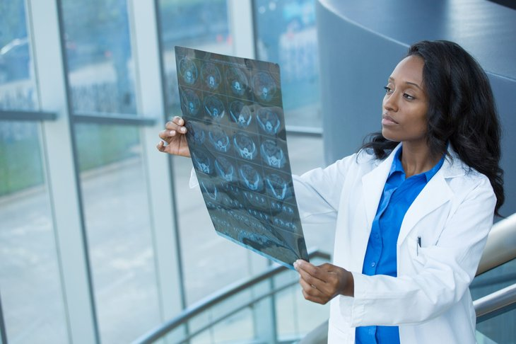 Female doctor looking at X-ray or other imaging test