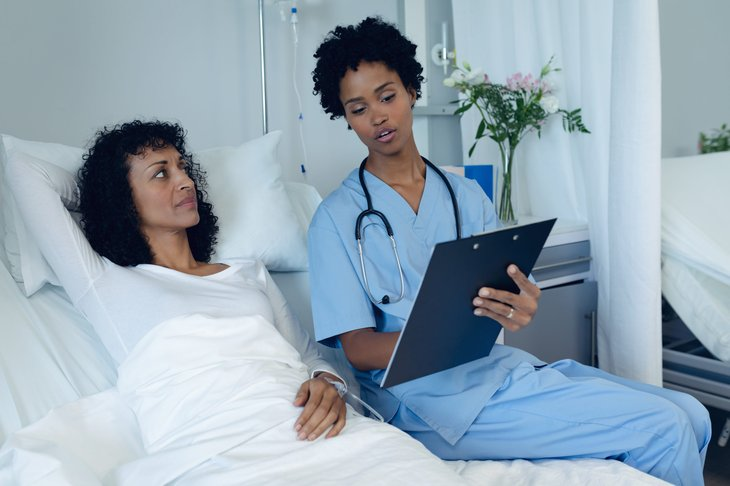 Female patient and doctor in the hospital