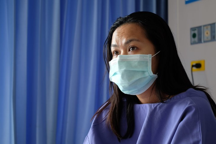 Woman wearing a mask at a hospital