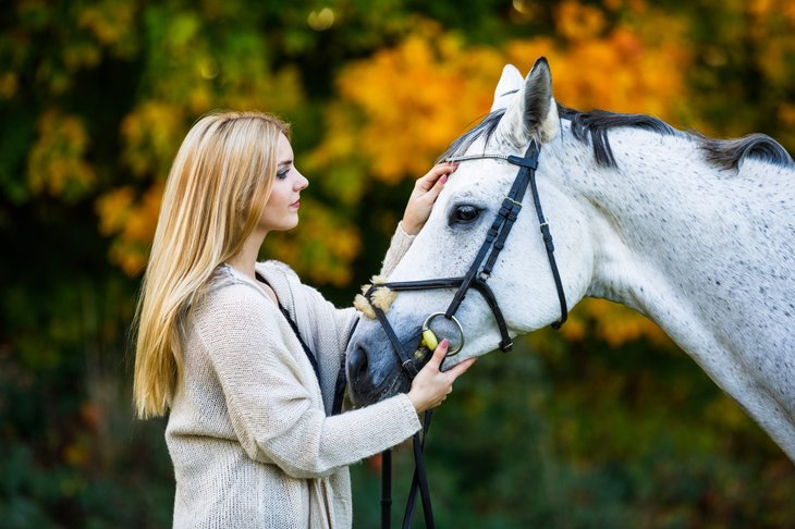 Hippotherapist with horse