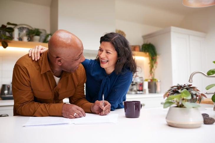 Senior couple signing mortgage paperwork