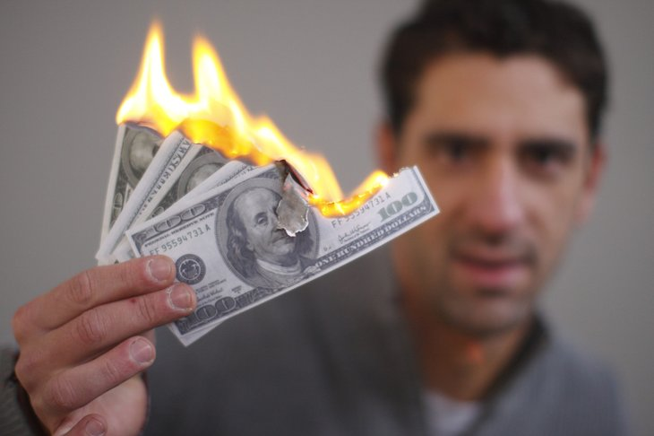 Man burning cash