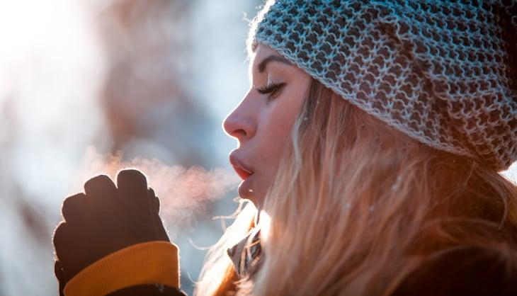 Freezing woman outside