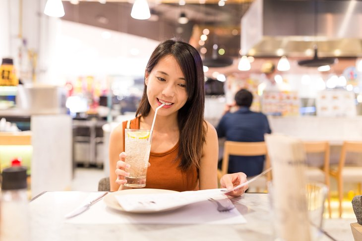 Woman drinking a beverage in a restaurant