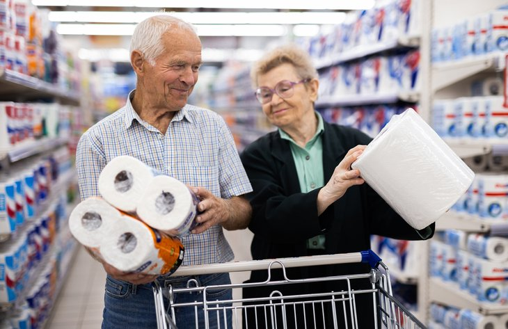 Couple buying paper towels