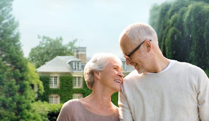 Happy senior couple retirees homeowners