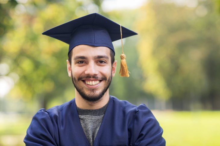 Man who graduates from college with a bachelor's or master's degree