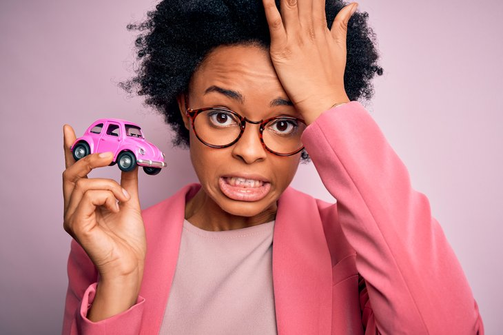 Upset woman with little car