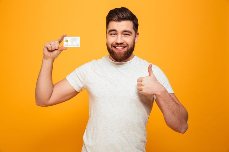 Man giving a thumbs up happy with his credit card rewards