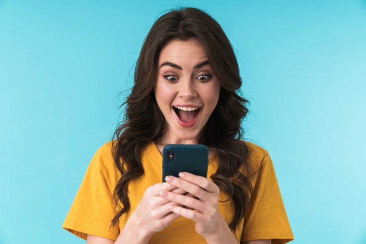 Woman excited by her low cell phone bill