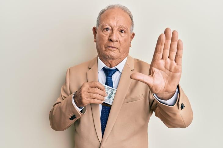Senior protecting his cash