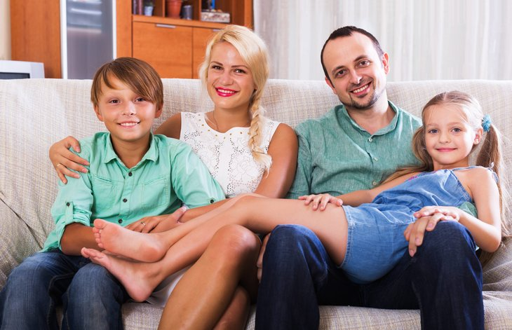 Happy middle class family at home