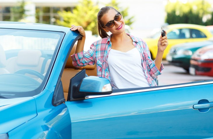 Buying a used car woman with key