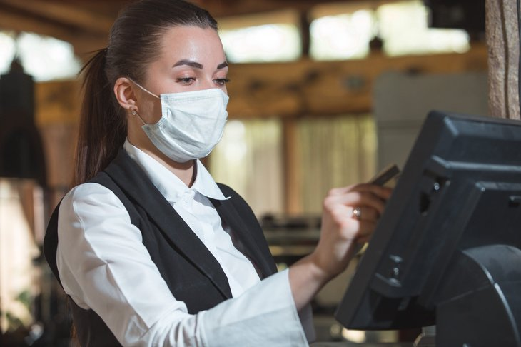 Restaurant worker in a mask