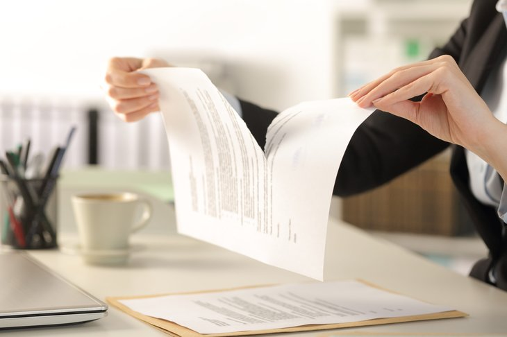 Woman ripping up a document