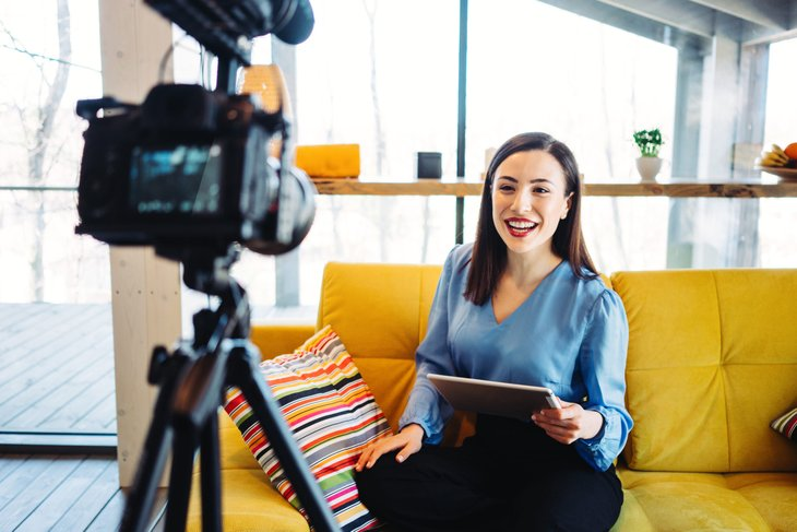 video blogger woman reading script