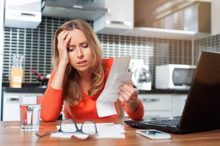Woman stressed about bills and taxes