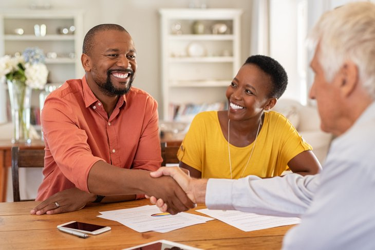 couple meeting with financial advisor insurance agent
