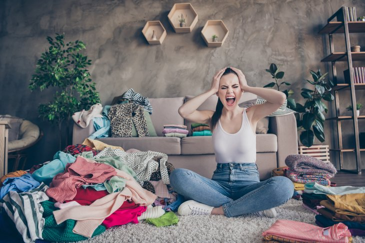 Stressed woman in a cluttered home