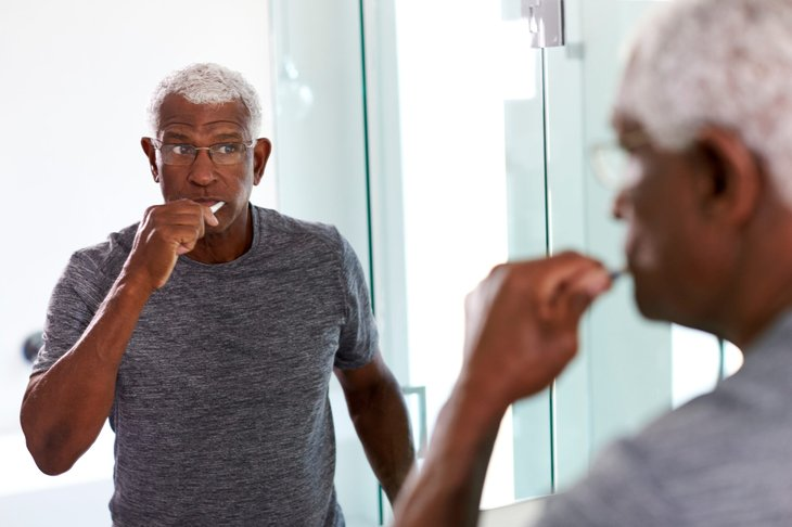 Senior man brushing teethSenior man brushing teeth