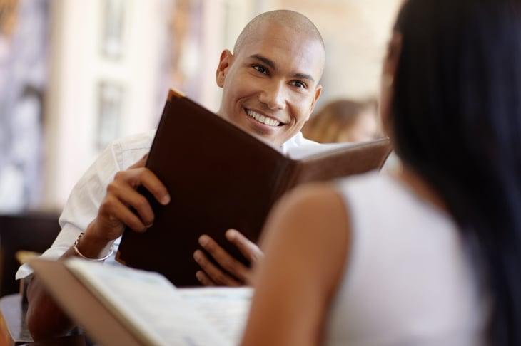 Man holding restaurant menu