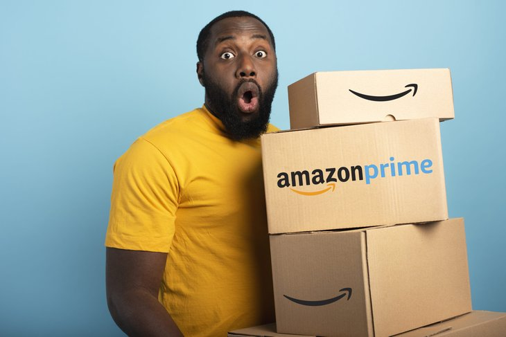 Amazon Prime member holding packages