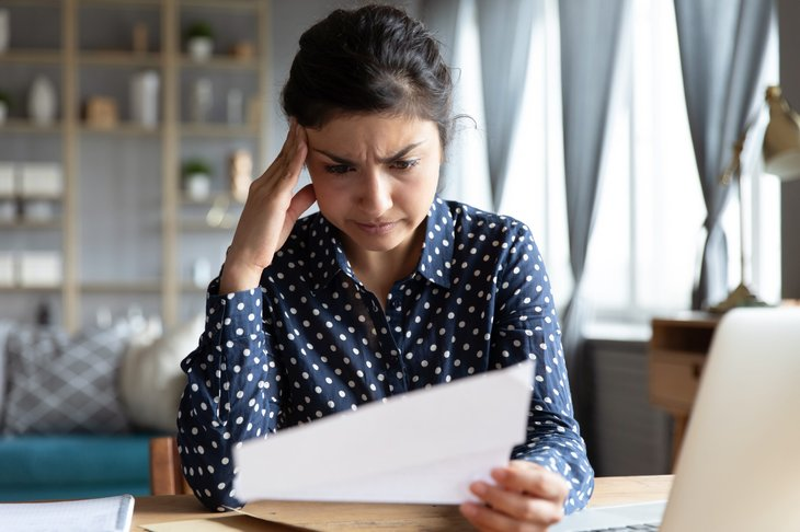 Woman looking at tax document
