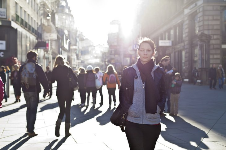 Woman on crowded city street