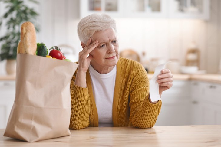 Upset senior worrying about grocery prices