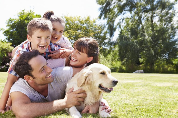 Happy, safe family outdoors with dog