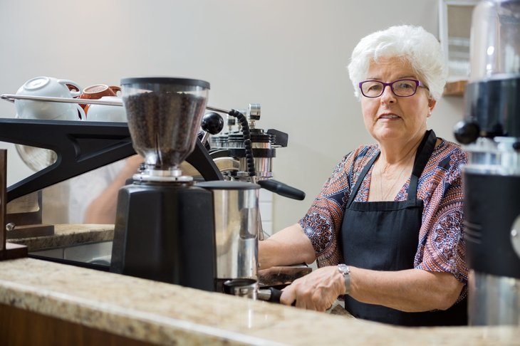 Senior woman working in coffee shop
