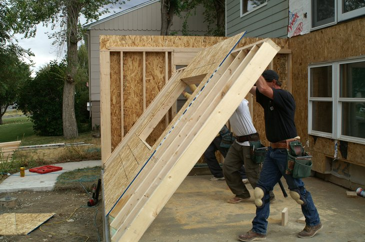 Workers building a home addition
