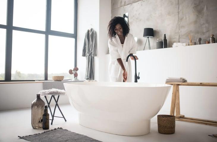 Woman filling a bathtub