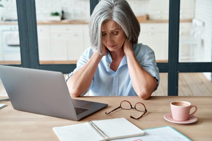 Upset older woman in pain