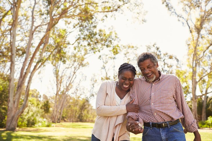 Older couple walking outdoors in a park