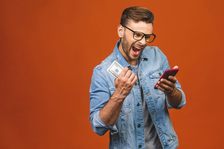 Man excited about savings on his cell phone smartphone plan
