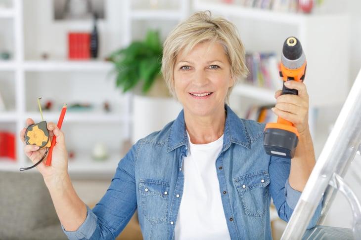 Senior woman doing home improvement