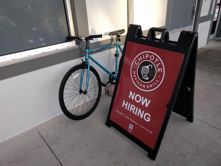 """'Now hiring"""" sign at Chipotle"""