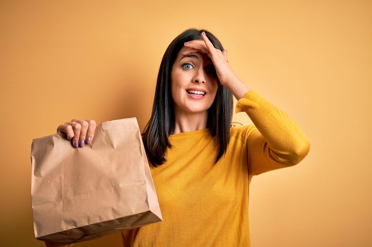 Upset woman with paper bag