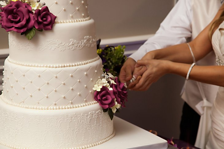 Couple slicing a wedding cake