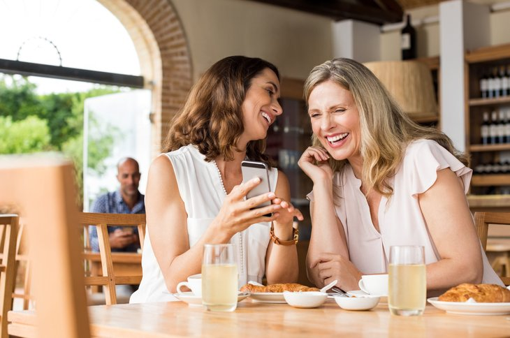 Friends laughing at a restaurant