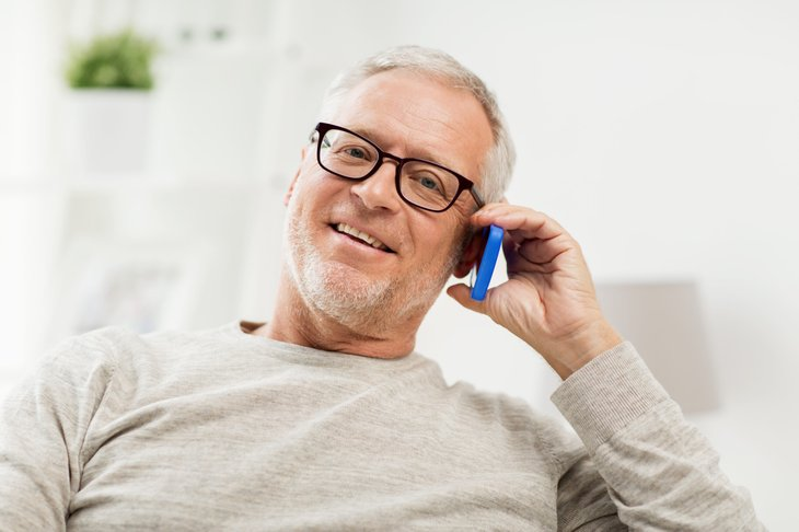 Senior man on the phone enjoying his smartphone plan